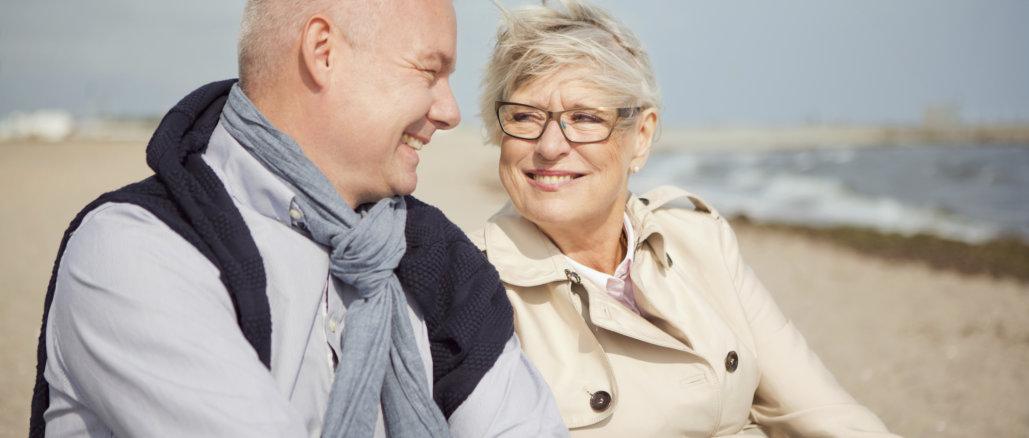 Senior couple by the sea.