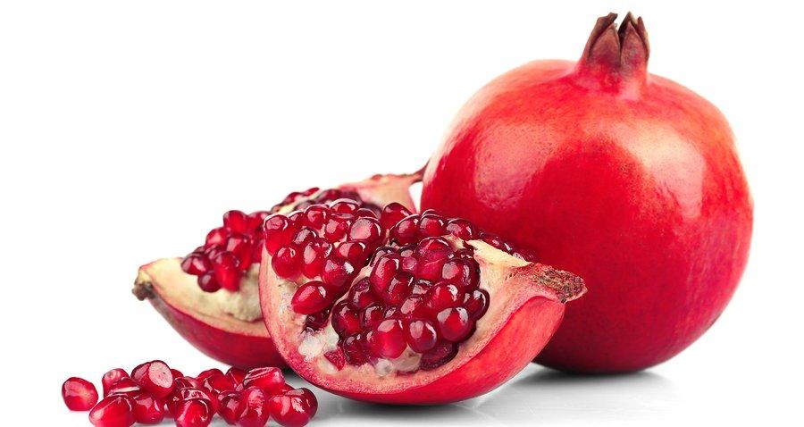 Juicy pomegranate isolated on white